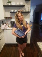 Dr. Lauren Thompson, FSU History Alumna, holding copies of her recently published book.